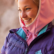 """Professional climber Sasha DiGiulian resting between routes at """"The Cathedral,"""" near St. George Utah."""
