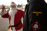 Santa Claus talks to an American Nazi Party member outside the Redneck Shop December 5, 2009 in Laurens, SC during the 7th Annual White Unity Christmas Party held by the American Nazi Party & International Knights of the Ku Klux Klan.
