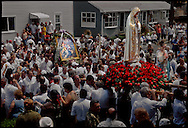 GLOUCESTER, MA- JUNE 29, 2003:  The statue of the Virgin Mary arrives outside a church during the annual celebration paying homage to St. Peter, the patron saint of fishermen in Gloucester, MA. The festa takes place on the weekend closest to the Feast Day of St. Peter, June 29. .(Photo by Robert Falcetti) . .