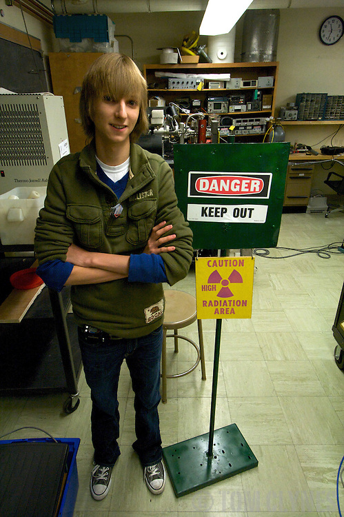 Taylor Wilson stands near  his fusion reactor, or fusor, in a laboratory in the Physics Department at the University of Nevada, Reno. Taylor Wilson is the youngest individual on Earth to have achieved a nuclear fusion reaction.