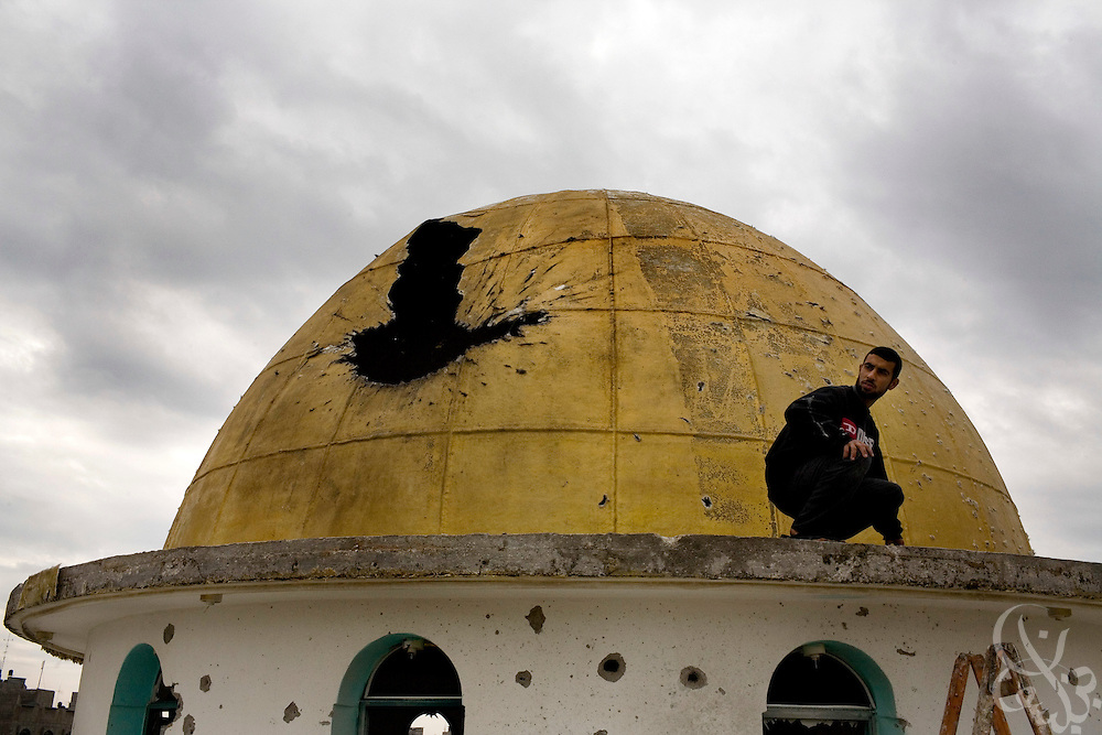 A Palestinian man inspects a damaged mosque dome in the Jabal al-Ariyas district of Gaza January 20, 2009.  According to estimates by Palestinian authorities, 14% of the total structures in the Gaza Strip have been damaged during the recent 21 day Israeli military operation against HAMAS. The total cost of damage from the operation is estimated at between 1.5 to 1.9 billion dollars. ....