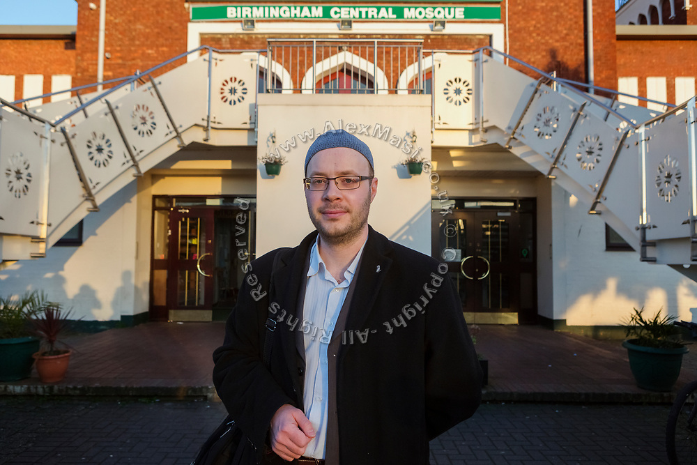 Paul Salahuddin Armstrong, co-director of The Association of British Muslims, is standing in front of Birmingham Central Mosque.