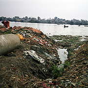 """The Buriganga river is now one of the most polluted rivers in Bangladesh due to dumping of industrial and human waste. A World Bank study said four major rivers near Dhaka -- the Buriganga, Shitalakhya, Turag and Balu -- receive 1.5 million cubic metres of waste water every day from 7,000 industrial units in surrounding areas and another 0.5 million cubic meters from other sources. """"The pollutants have eaten up all oxygen in the Buriganga and we call it biologically dead. It is like a septic tank,"""" said Khawaja Minnatullah, a World Bank specialist on environment and water management.""""There is no fish or aquatic life in this river apart from zero oxygen survival kind of organisms."""" Chemicals such as cadmium and chromium, and other elements such as mercury carried by the industrial waste are also creeping into the ground water, posing a serious threat to public health.."""