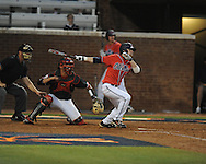 Mississippi's Tanner Mathis (12) hits an RBI triple vs. St. John's during an NCAA Regional at Davenport Field in Charlottesville, Va. on Friday, June 4, 2010.