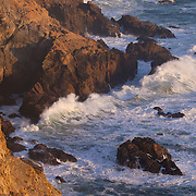 Pacific Ocean waves crash into and erode the rugged coastline at the Point Reyes National Seashore in Marin County, California.