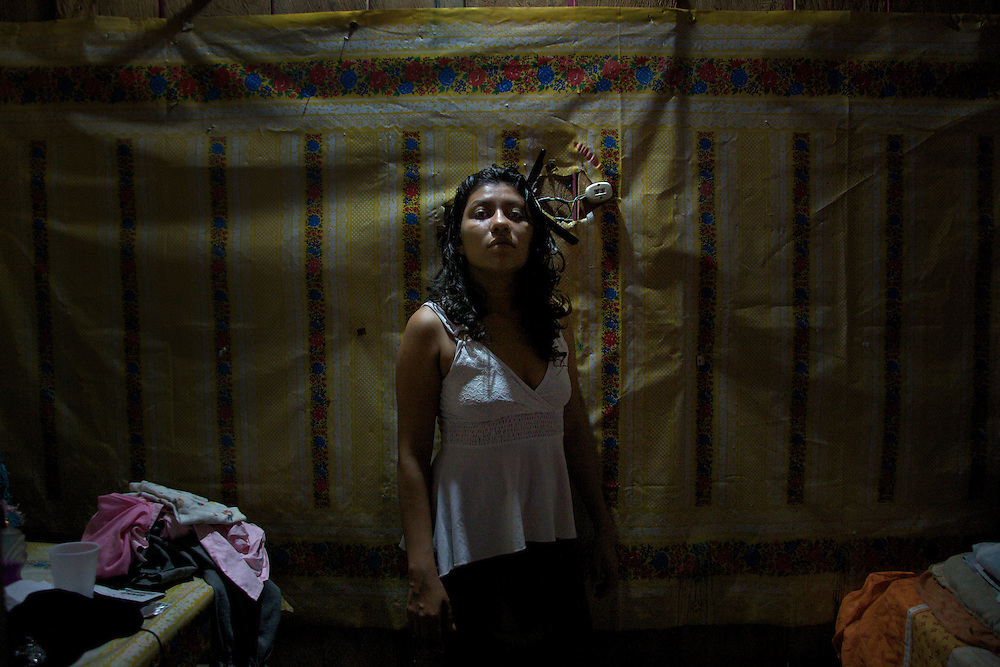 Milena standing on her room, Frontera Chiapas. Prostitution on Mexican Southern Border