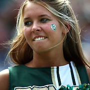 SHOT 9/1/2007 - A Colorado State cheerleadercheers during the first half of the Rocky Mountain Showdown Saturday September 1, 2007 at Invesco Field in Denver, Co. The University of Colorado won the Centennial Cup with a 31-28 overtime victory in the game. Colorado and Colorado State have met 78 times in their histories, but the first 69 took place on their respective campuses. The Colorado Buffaloes are in the Big 12 Conference, while the Colorado State Rams compete in the Mountain West Conference..(Photo by Marc Piscotty © 2007)