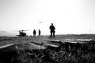 U.S. Navy security force secure a helicopter landing zone in Port-au-Prince, Haiti.
