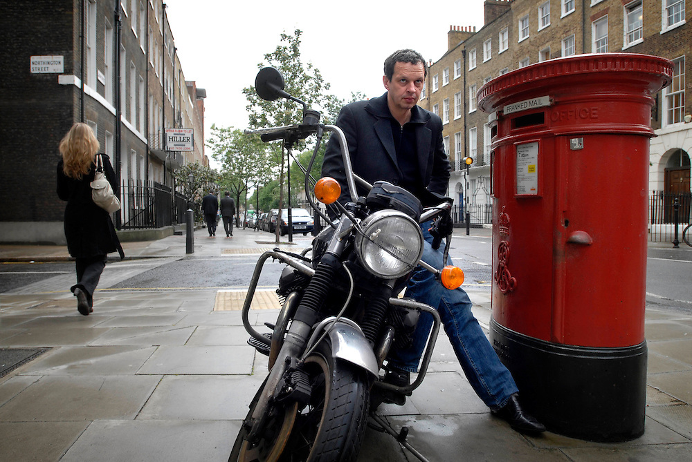 UK. London. Designer Tom Dixon outside his studio in central London. Photo shows Tom with his Moto Guzzi 850cc T3 California 1978. .Photo©Steve Forrest/Workers' Photos