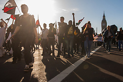 London, March 7th 2015. Following the Climate march through London, masked anarchists and environmental activists clash with police following a breakaway protest at Shell House. PICTURED: Protesters march across Westminster Bridge towards Shell House.