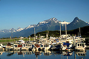 Alaska. Valdez boat harbor with  Chugach Mts beyond.