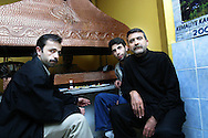 A Kurdish restaurant owner and his friends in his restaurant in Istanbul, Turkey..
