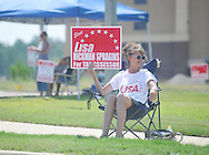 Lisa Spragins, candidate for tax assessor of Lafayette County, holds a sign as she campaigns outside the polls at the Oxford Conference Center in Oxford, Miss. on Tuesday, August 23, 2011. (AP Photo/Oxford Eagle, Bruce Newman)