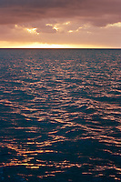 Sunset and clouds over a the sea in the Fiji archipelago..