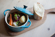 Slow-cooked Old Spot, Black Shetland potato, silver skin onion, chantenay carrot, leek & soya bean casserole served with crusty French bread at The Milk House Restaurant & pub in, Sissinghurst, UK. CREDIT: Vanessa Berberian for The Wall Street Journal. UKWINE