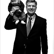 """Rep. Bill Crane, R-Arvada, holds his two month old grandson Logan Bennington (cq) on his shoulder as they pose for a portrait. Crane is a retired business systems engineer and was photographed with his six grandchildren. Crane said he brought his grandchildren because, """"they're a reflection of me"""". Crane is 57 years old..(Photo by MARC PISCOTTY / ©2006) CQ Rep. Bill Crane, R-Arvada and Logan Bennington"""