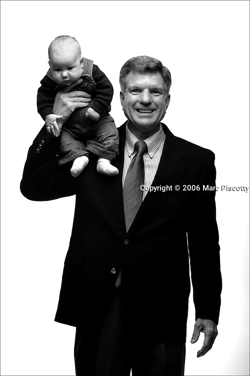 "Rep. Bill Crane, R-Arvada, holds his two month old grandson Logan Bennington (cq) on his shoulder as they pose for a portrait. Crane is a retired business systems engineer and was photographed with his six grandchildren. Crane said he brought his grandchildren because, ""they're a reflection of me"". Crane is 57 years old..(Photo by MARC PISCOTTY / ©2006) CQ Rep. Bill Crane, R-Arvada and Logan Bennington"