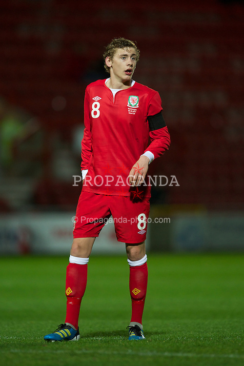 WREXHAM, WALES - Saturday, October 8, 2011: Wales' Elliott Hewitt in action against Montenegro during the UEFA Under-21 Championship Qualifying Group 3 match at the Racecourse Ground. (Pic by David Rawcliffe/Propaganda)