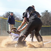 Goldey-Beacom pitcher Roni Peters (6) is tagged at home plate by Post University catcher Stephanie DeMartino (10) in the sixth inning of a NCAA Central Atlantic Collegiate Conference game between Post University and Goldey-Beacom Saturday, March 30, 2013, at Nancy Churchmann Sawin Athletic Field in Wilmington Delaware...Post University defeats Goldey-Beacom 4-3
