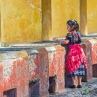 ANTIGUA , GUATEMALA - JULY 30 : Guatemalan girl wash laundry in a traditional street washing facility in Antigua, Guatemala on July 30 2015.