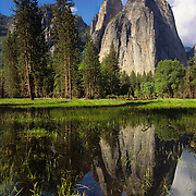 Cathedral Spires reflect in a flooded meadow in Yosemite National Park, CA.