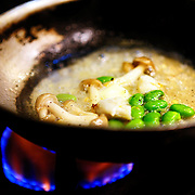 "SHOT 2/17/12 7:49:29 PM - Mushrooms and edamame simmer in a prep pan at TAG restaurant on Larimer Square in downtown Denver, Co. The restaurant is operated by chef/owner Troy Guard. TAG features what they term ""continental social food"" and features influences from numerous continents. (Photo by Marc Piscotty / © 2012)"