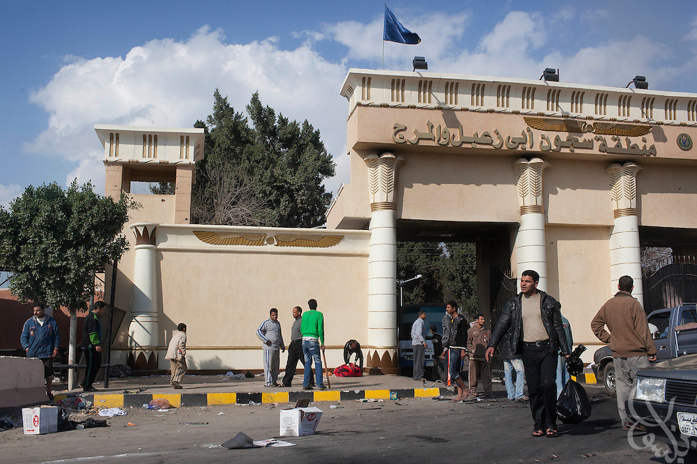 Looters are still seen at the entrance to Abu Za'abal prison following an attack last night by looters and reports of prisoner escapes January 30, 2011 near the village of Abu Za'abal in the Qalyoubia district of Egypt north of Cairo.
