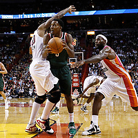 22 January 2012: Miami Heat power forward Udonis Haslem (40) and Miami Heat small forward LeBron James (6) defend on Milwaukee Bucks point guard Brandon Jennings (3) during the Milwaukee Bucks 91-82 victory over the Miami Heat at the AmericanAirlines Arena, Miami, Florida, USA.
