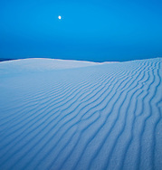 A full moon rises and lights the dunes of White Sands National Monument, New Mexico