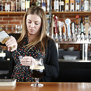 """SHOT 3/25/14 2:58:25 PM - Euclid Hall bar manager Jessica Cann of Denver, Co. prepares a """"Return of the Naughty Girl Scout"""", a beer cocktail that mixes chocolate liquer, coffee liqueur, peppermint schnapps, and Left Hand Nitro Milk Stout beer $11. (Photo by Marc Piscotty / © 2014)"""