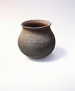 0100-1012 ~ George H. H. Huey ~ Tusayan corrugated jar. Anasazi culture ca. A.D. 1000's-1200's. Canyon de Chelly National Monument, Arizona.