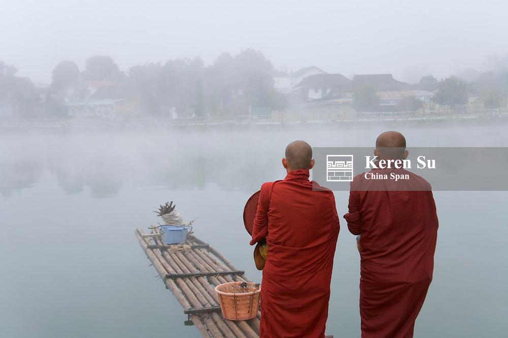 Monks with Nwang Tung Lake in mist, Kengtung, Myanmar