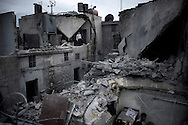 SYRIA, ALEPPO. A Syrian man inspects the remains of his destroyed house following an airstrike by the Syrian airforce in the northern Syrian city of Aleppo. ALESSIO ROMENZI