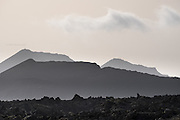 Dusk haze from Moroccon trade winds, partially softening Timanfaya National Park (Fire Mountain), Lanzarote