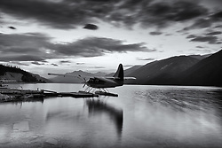 Muncho Lake black and white floatplane reflections