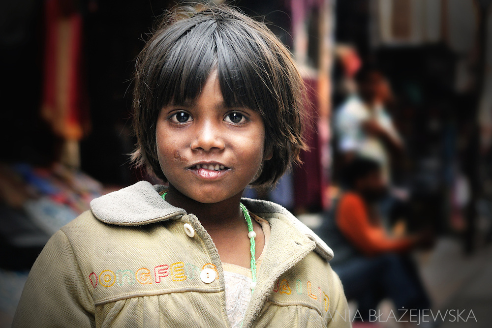 Nepal, Kathmandu. Portrait of a poor begging girl on the street in Thamel, touristic district in Kathmandu.