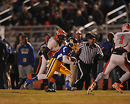 Oxford High's Glenn Gordon (11) runs vs. Jackson Callaway's Kevin Jones (20) in a MHSAA North 5A playoff game in Oxford, Miss. on Friday, November 29, 2013. Oxford won 23-7 to advance to the Class 5A championship game against Picayune.
