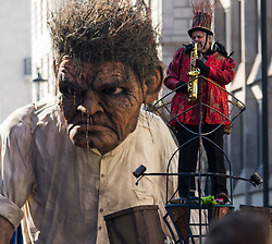 London, March 13th 2016. The annual St Patrick's Day Parade takes place in the Capital with various groups from the Irish community as well as contingents from other ethnicities taking part in a procession from Green Park to Trafalgar Square.  PICTURED: A giant &quot;Crom&quot; from the Macnas street theatre company in Co Galway dwarfs one of the performers. &copy;Paul Davey<br /> FOR LICENCING CONTACT: Paul Davey +44 (0) 7966 016 296 paul@pauldaveycreative.co.uk