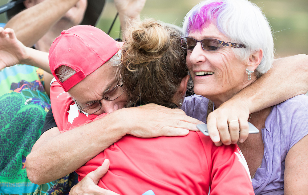 Catharine Pendrel hugs her parents Bruce Pendrel and Johanna Bertin following winning the Bronze medal in the Mountain Bike competition at the Rio Olympics on August 20, 2016.