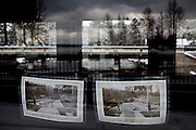 Historic photos of the construction of the Lake Tahoe Dam in the windows of the dam in Tahoe City, Calif., February 28, 2012..