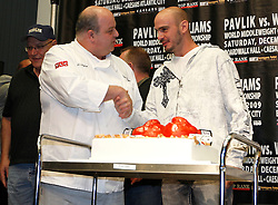 "Sept 29, 2009; East Rutherford, NJ, USA; Kelly Pavlik (r) receives a cake from Mauro Castano, one of the stars the the TLC show ""The Cake Boss"" during the press conference announcing the December 5, 2009 World Middleweight Championship fight between Kelly Pavlik and Paul Williams. The two will meet at Boardwalk Hall in Atlantic City, NJ.  Mandatory Credit: Ed Mulholland"
