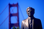 Image of the Golden Gate Bridge in  San Francisco, California, with a statue of designer Joseph Strauss