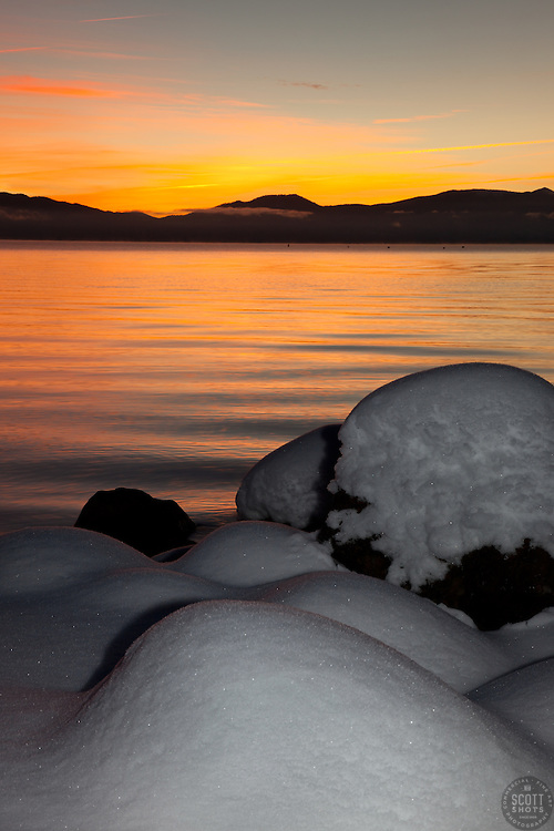 """Snowy Sunrise at Lake Tahoe 1"" - These snow covered boulders were photographed at sunrise on the shore of Commons Beach in Tahoe City, Lake Tahoe."