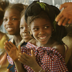 Manema Walet Issafeytane, the animatrice for the village of Intedeyne, sings songs with children including Zida, to the left of her wearing a headscarf,  March 17, 2007. Mali is one of the poorest countires in the world with 90 percent of the population living on less than $2 per day.