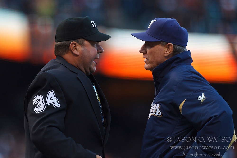 July 23, 2011; San Francisco, CA, USA;  Milwaukee Brewers manager Ron Roenicke (right) argues a call with umpire Sam Holbrook (34) during the fourth inning against the San Francisco Giants at AT&T Park. San Francisco defeated Milwaukee 4-2.