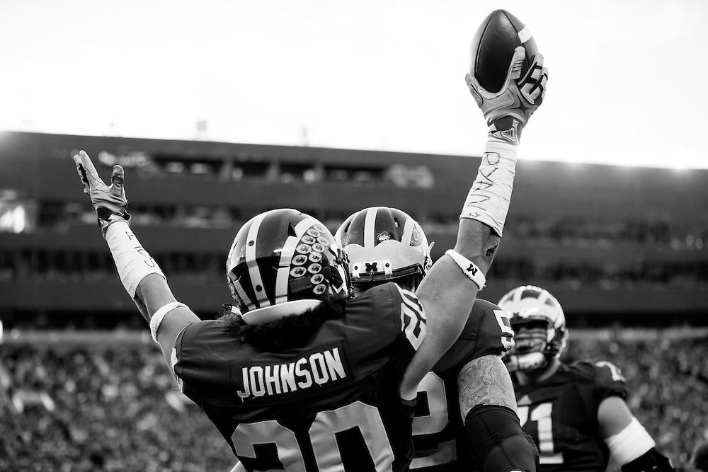 Nov 7, 2015; Ann Arbor, MI, USA; Michigan Wolverines running back Drake Johnson (20) celebrates his touchdown in the second quarter against the Rutgers Scarlet Knights at Michigan Stadium. Mandatory Credit: Rick Osentoski-USA TODAY Sports