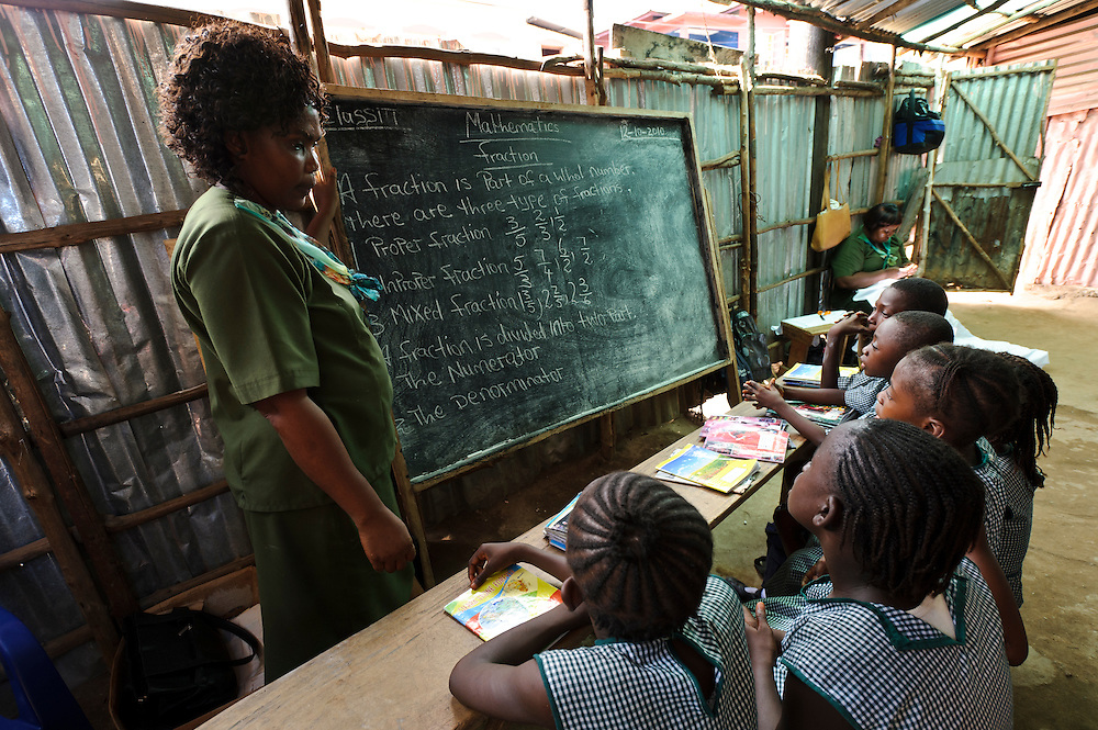 A class at Planting Promise's school, Freetown, Sierra Leone. Planting Promise is an organization dedicated to the development of education in Sierra Leone. Its aim is to bring opportunities to initiate self-run, self-supporting projects that offer real solutions to the difficulties facing the world's poorest country. They believe real and lasting development comes from below, from local projects that address specific needs, rather than large international models. To this end, they currently run five projects that aim to bring wealth into the country through business. The profits from these businesses are then used to support free education for children and adults...Through the combination of business with social progress, the charity hopes that they are providing real, lasting and profound changes for the better, by promoting sustainable and beneficial industry in the country, and putting it to the service to the needs of the people. As well as providing the income to fund the school, the farms will also be an example of successful commercial enterprise to teach the children in the school the viability of profit-making schemes that go beyond subsistence models, the only things the children of these desperately poor areas are accustomed to. By learning particular details of the challenges that they will face, the children will emerge from this school equipped to contribute in a real way to their society.
