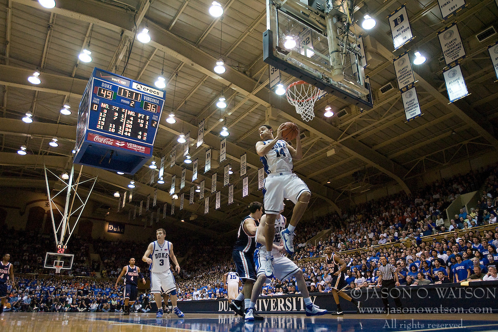 Duke forward David McClure (14) grabs a rebound against UVA.  The Duke Blue Devils defeated the Virginia Cavaliers 87-65 in men's basketball at Cameron Indoor Stadium on the campus of Duke University in Durham, NC on January 13, 2008.
