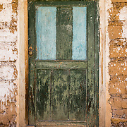 A weathered green door in Hualcayan village, in the Cordillera Blanca, Andes Mountains, Peru, South America. The photo is from our last day of 10 days trekking around Alpamayo in Huascaran National Park.