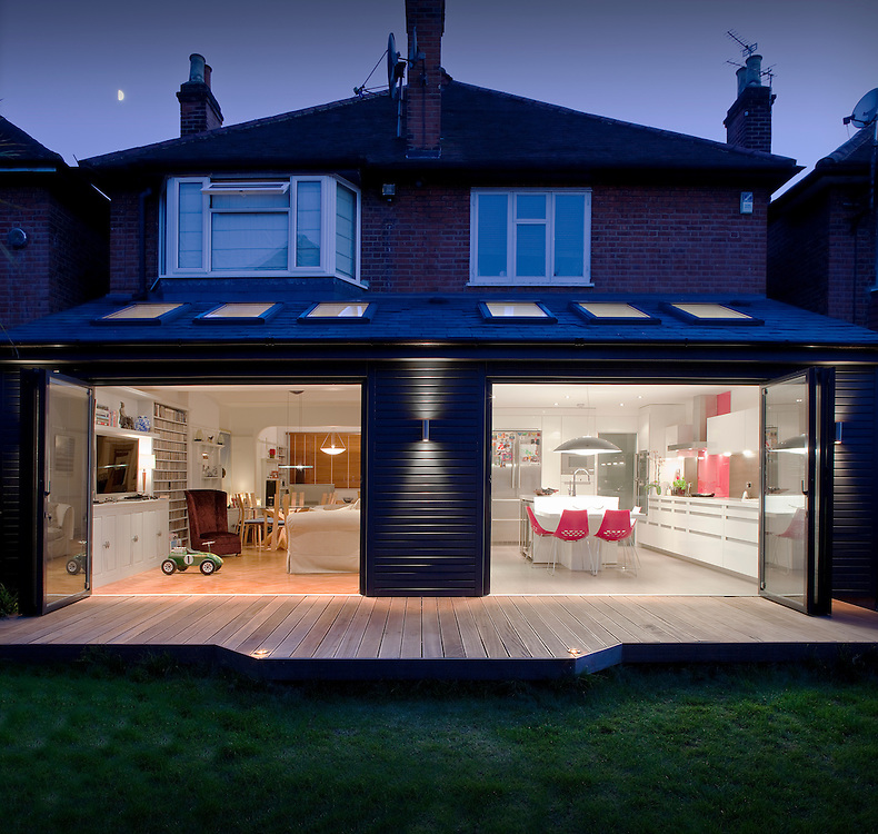 House extension in chiswick at dusk shot from garden and for House extension interior designs